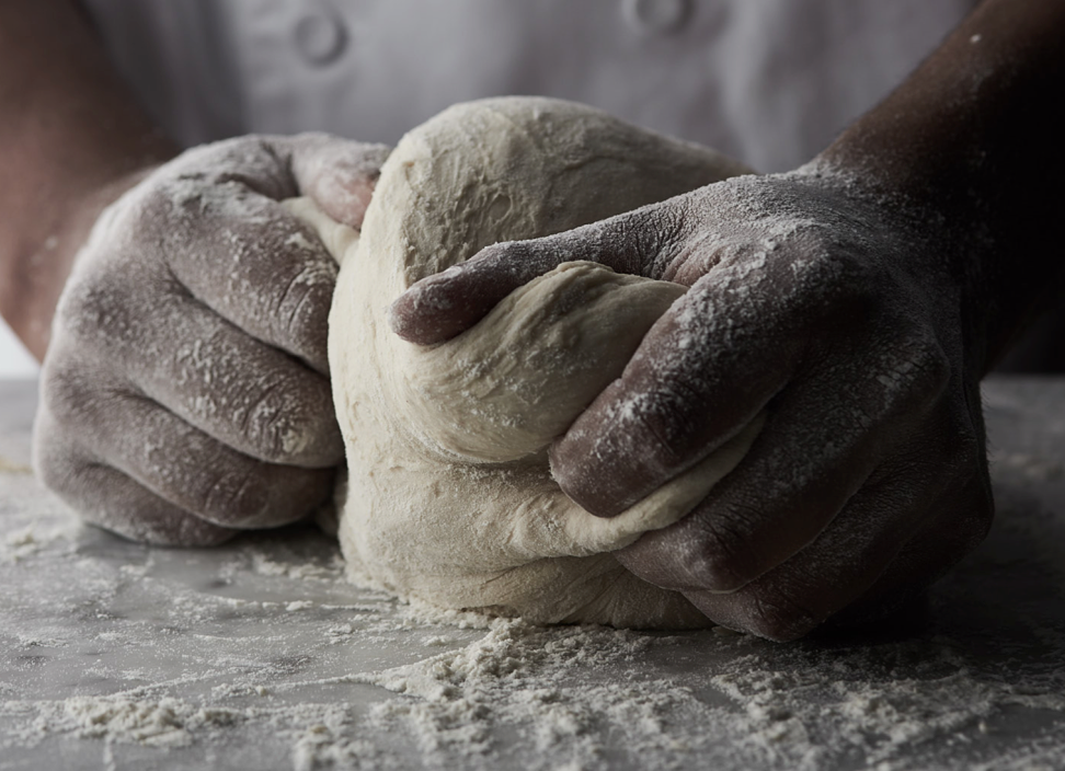 photo of chef kneading dough