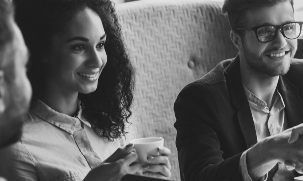 photo of a man and a woman drinking coffee
